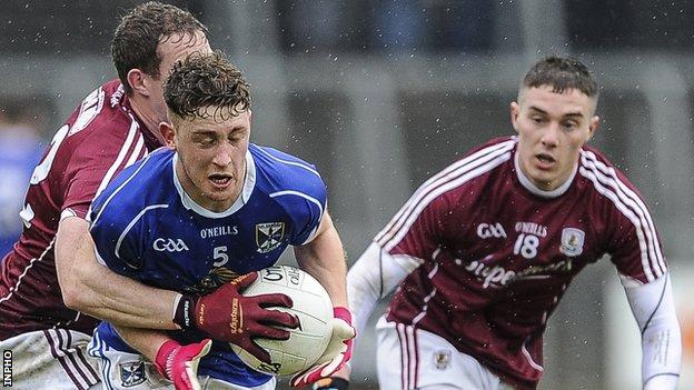 Cavan's Ciaran Brady in action against Gary Sice and Eamon Brannigan of Galway
