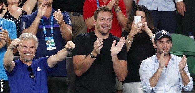 Piotr Wozniacki (L), coach and father of Caroline Wozniacki and her fiance David Lee celebrate