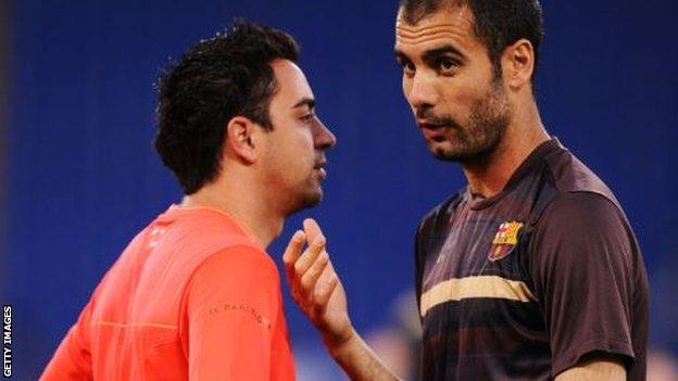 Xavi and Pep Guardiola
