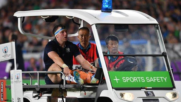 Scotland flanker Hamish Watson is driven off from field injured