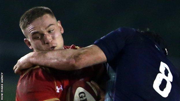 Harrison Keddie is tackled by Matt Smith of Scotland U20