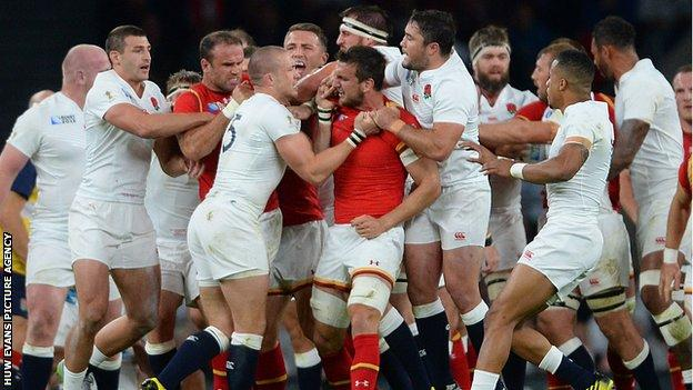 England full-back Mike Brown and Wales captain Sam Warburton scuffle during the World Cup game at twickenham