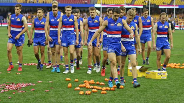 The Bulldogs leave the field through Easter eggs on the ground after losing the round two AFL match between the Western Bulldogs and the West Coast Eagles at Etihad Stadium on April 1, 2018 in Melbourne, Australia
