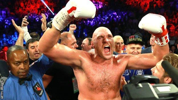 Tyson Fury celebrates after his second round win