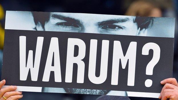 A fan holds up a banner asking Mats Hummels 'why?' at a recent Borussia Dortmund game