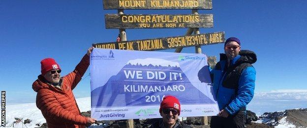 Aaron Phipps at the summit of Mount Kilimanjaro