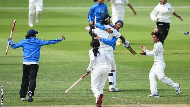 India celebrate beating England in 2014
