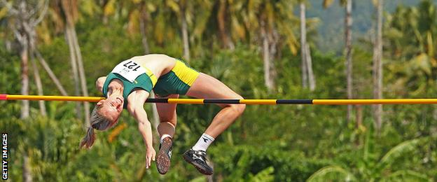 Woman competes in a high jump competition