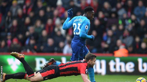 Simon Francis attempts to thwart Danny Welbeck