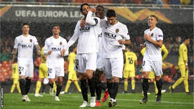 Valencia's players celebrate scoring against Villarreal in the Europa League
