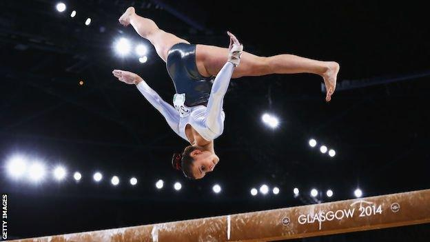 Hannah Whelan competing at the 2014 Commonwealth Games on the beam