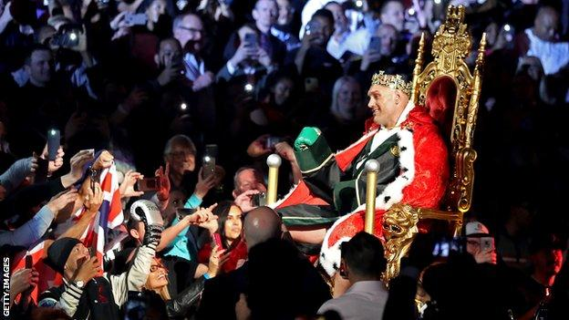 Tyson Fury is carried to the ring on a throne before his heavyweight bout against Deontay Wilder