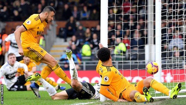 Romain Saiss scores Wolves' equaliser against Fulham