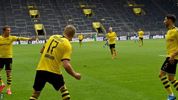 Dortmund players observed social distancing protocol as they celebrated Haaland's goal