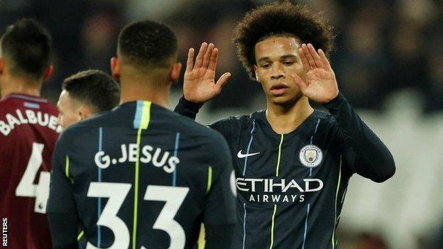 Leroy Sane celebrates with Manchester City team-mate Gabriel Jesus