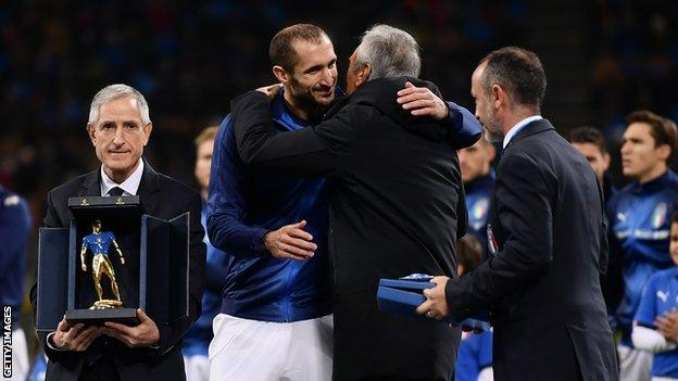 Giorgio Chiellini (second left) is honoured prior to play his 100th cap with the Italian national team