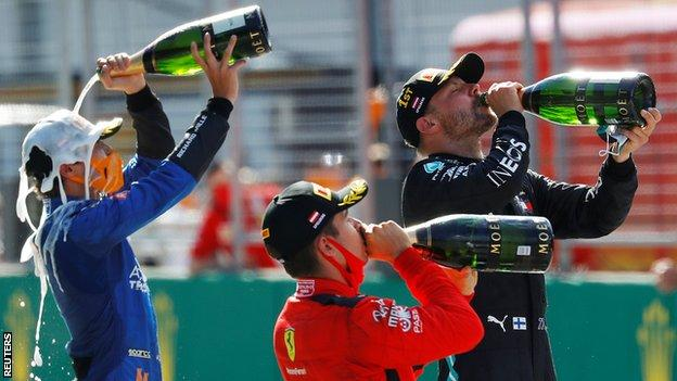 Norris, Bottas and Leclerc all celebrate with champagne