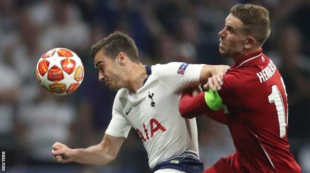 Tottenham's Harry Winks is challenged by Liverpool's Jordan Henderson