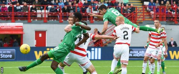 Dedryck Boyata is alert to the free-kick from Leigh Griffiths as he knocks in Celtic's first goal