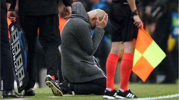 Manchester City manager Pep Guardiola sinks to his knees and puts his head in his hands after Raheem Sterling's late goal against Spurs in the Champions League quarter-final is disallowed