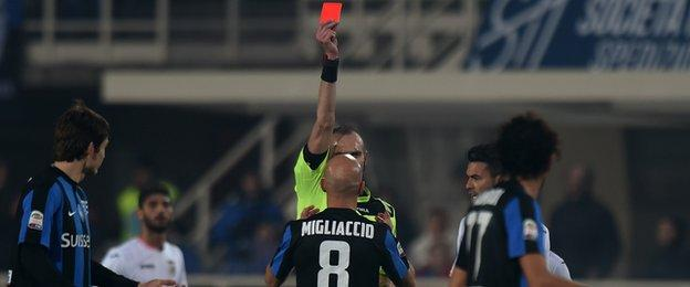 Atalanta midfielder Giulio Migliaccio is sent off against Palermo