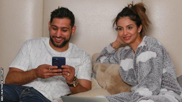 Amir Khan and Faryal Makhdoom on the sofa.