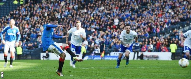 Andy Halliday scores a penalty for Rangers against Peterhead