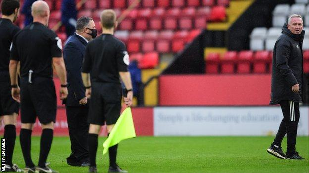 Ipswich Town manager Paul Lambert speaks to Referee Kevin Johnson following defeat by Lincoln