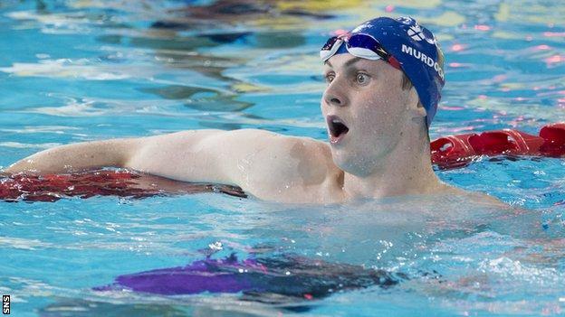 Ross Murdoch looks shocked after winning Commonwealth gold in 2014