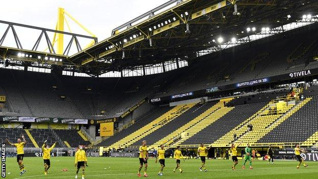Borussia Dortmund players ran over to celebrate in front of the empty South Bank