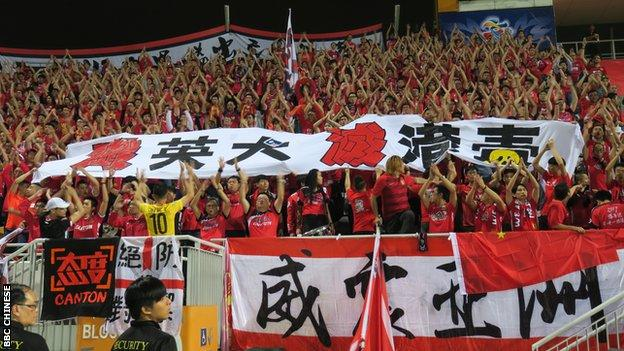 """Guangzhou Evergrande fans show a banner that reads """"Annihilate British dogs, extinguish HK independence poison"""" during the match at the Mong Kok Stadium in Hong Kong, 25 Apr 2017."""