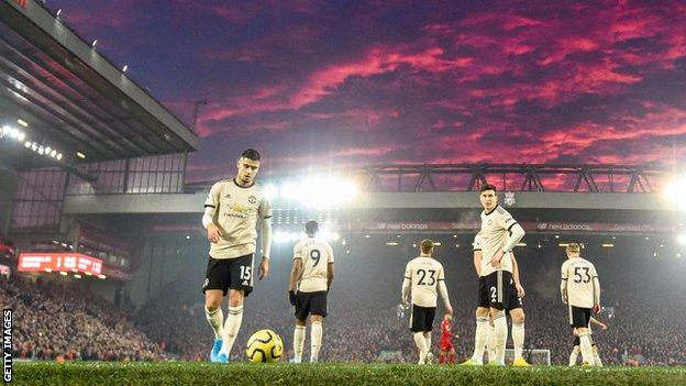 Manchester United players look dejected at Anfield in January last year