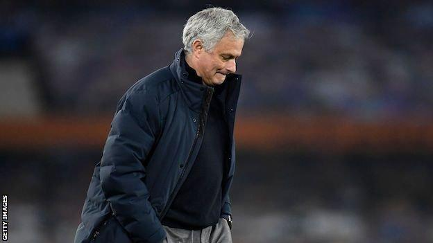 Jose Mourinho walks with his hands in his pocket, looking at the ground