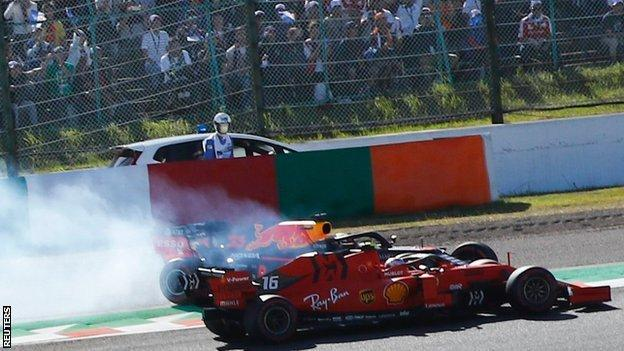 The cars of Max Verstappen and Charles Leclerc collide