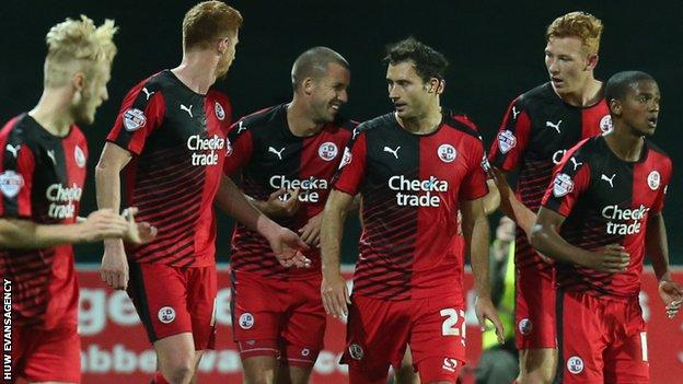 Crawley celebrate Gwion Edwards' first goal at Rodney Parade