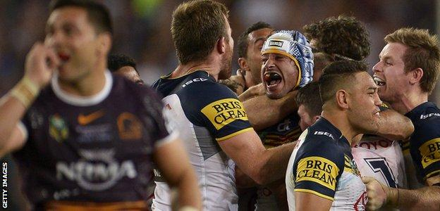 Johnathan Thurston of the Cowboys celebrates with team mates after kicking the winning field goal during the 2015 NRL Grand Final