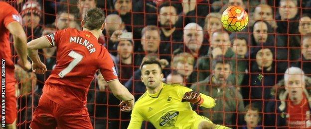 James Milner puts his penalty past Lukasz Fabianski