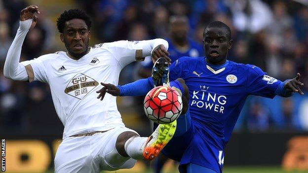 Leroy Fer of Swansea City and N'Golo Kante of Leicester City stretch for the ball during a Premier League match