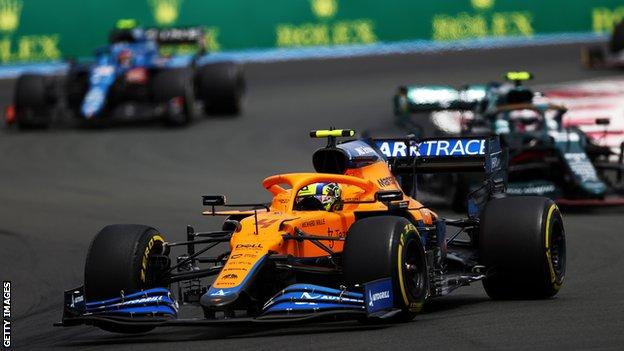 Lando Norris passes the Aston Martin and Alpine at the French Grand Prix