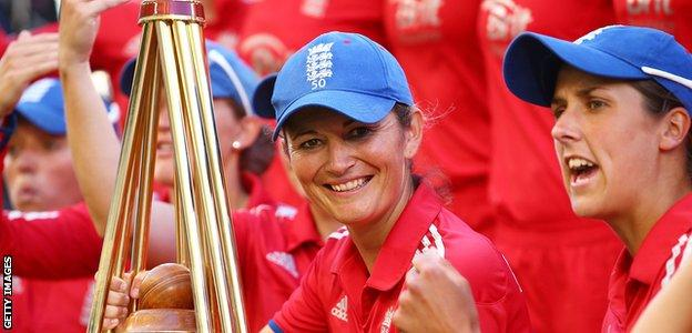 Former England captain Charlotte Edwards with a trophy in her playing days