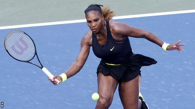 Serena Williams returns a shot in the Western & Southern Open