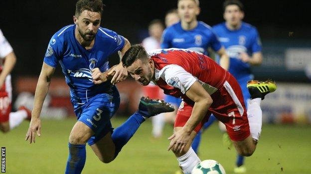 Dungannon Swifts' Christopher Hegarty and Andrew Waterworth of Linfield