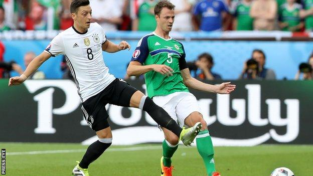 Jonny Evans battles with Germany's Mesut Ozil in the game at Euro 2016