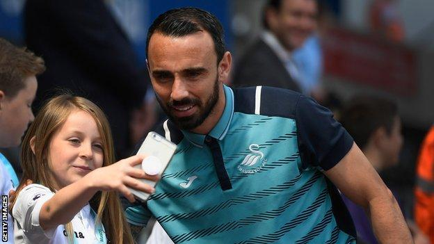Leon Britton and a young fan