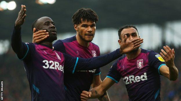Albert Adomah, Tyrone Mings and Ahmed Elmohamady celebrate Aston Villa's equaliser at Stoke City