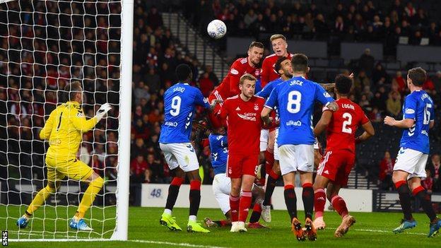 Lewis Ferguson scores