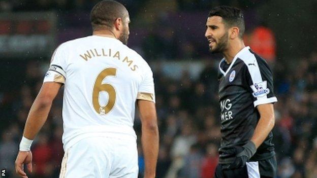 Swansea City's Ashley Williams and Leicester City's Riyad Mahrez