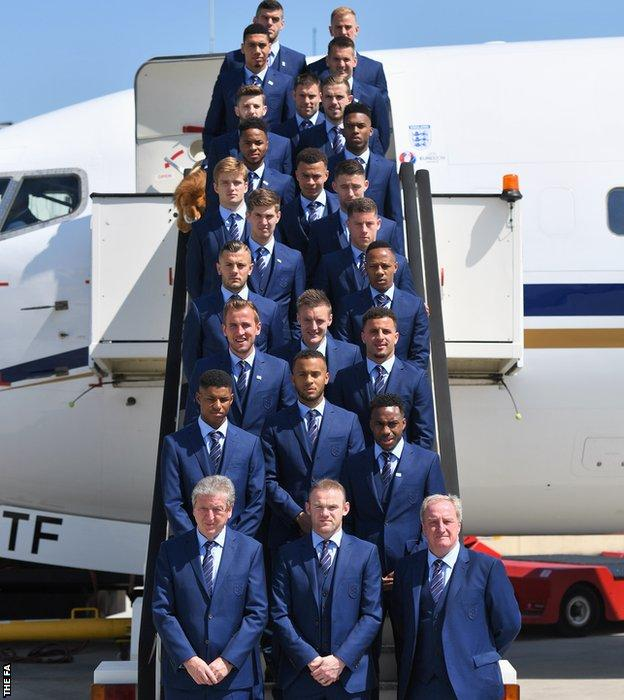 The full 23-man England squad and management team prepare to board their plan to France for Euro 2016