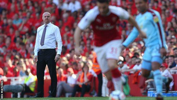 Burnley manager Sean Dyche watches his side