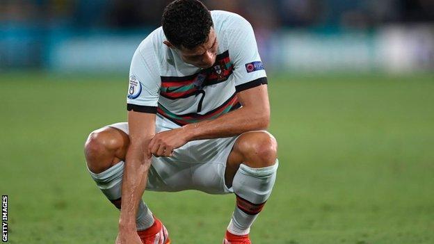 Ronaldo crouches to the turf